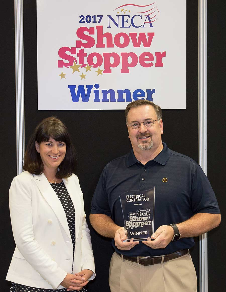 Bridgeport's Larry Smith accepts ShowStopper award from EC Publisher Andrea Klee